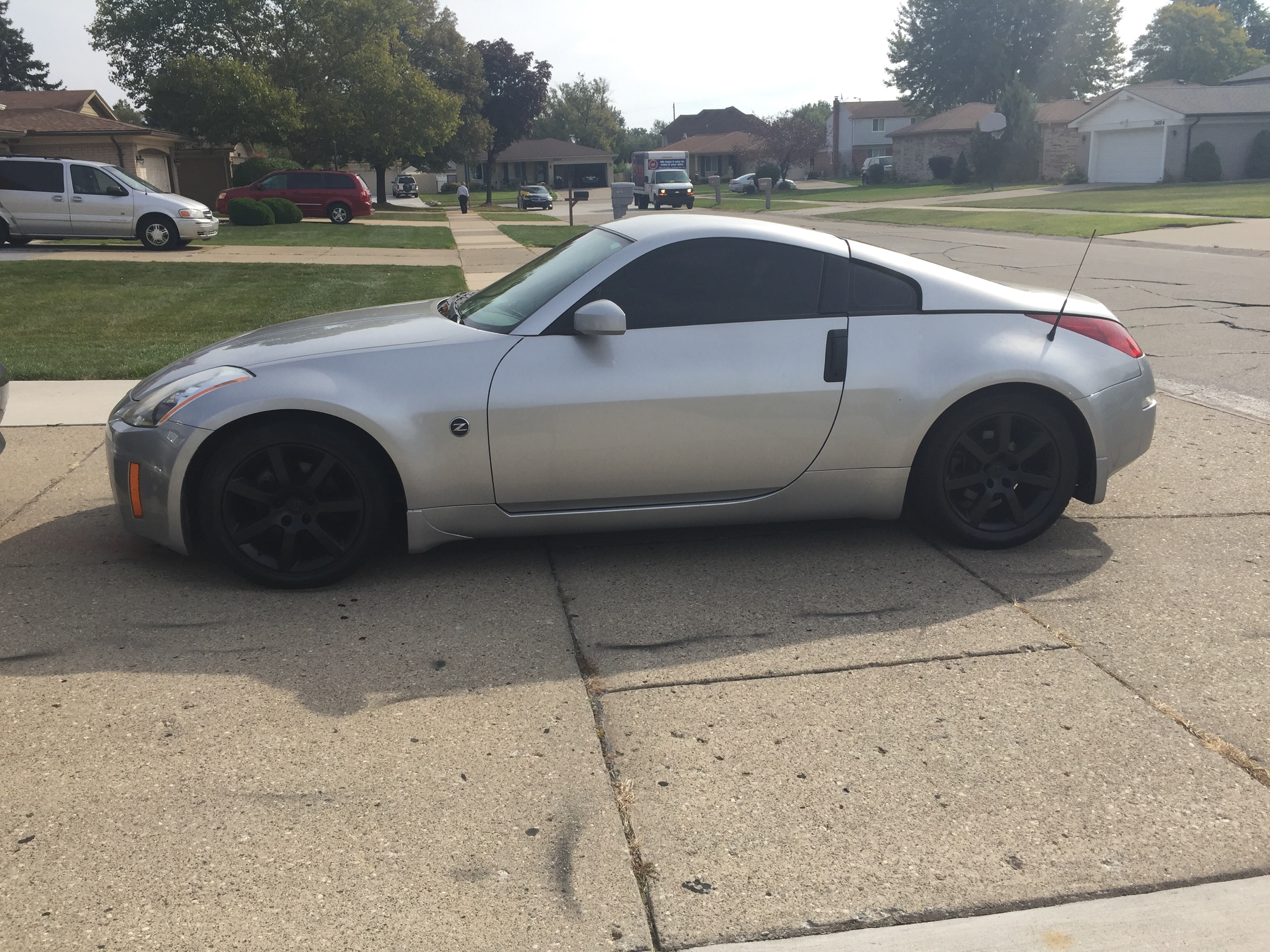 nissan 350z 2015 black. 2004 nissan 350z rims emblems and door handles done in gloss black 350z 2015